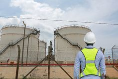 Back view of Male construction worker against gas separation plant.  royalty free stock photo