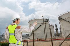 Back view of Male construction worker against gas separation plant.  stock photography