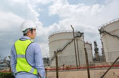Back view of Male construction worker against gas separation plant.  royalty free stock photos