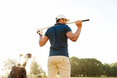 Back view of a male golf player at the course with a club sack Stock Photo