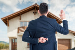 Back view of male realtor with finger crossed Royalty Free Stock Images
