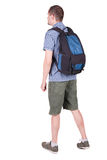 Back view of man with   backpack looking up. Royalty Free Stock Images