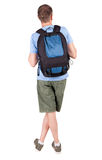 Back view of man with   backpack looking up. Stock Images