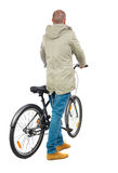 Back view of a man with a bicycle. Stock Photos