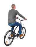 Back view of a man with a bicycle. Stock Images