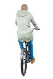 Back view of a man with a bicycle. Royalty Free Stock Image