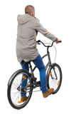 Back view of a man with a bicycle. Royalty Free Stock Photos
