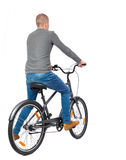 Back view of a man with a bicycle. Royalty Free Stock Photography