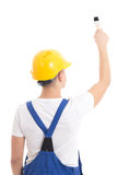 Back view of man builder in blue uniform and helmet writing some Royalty Free Stock Image