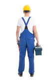 Back view of man in builder uniform and helmet with toolbox isol Royalty Free Stock Images