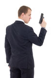 Back view of man in business suit with gun isolated on white. Background royalty free stock image