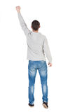 Back view of  man in checkered shirt Raised his fist up in victo. Ry sign.   Rear view people collection.  backside view of person.  Isolated over white Stock Image