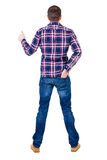 Back view of  man in checkered shirt shows thumbs up. Royalty Free Stock Photo