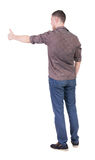 Back view of  man in checkered shirt shows thumbs up. Rear view people collection.  backside view of person.  Isolated over white background. Unshaven man Stock Image