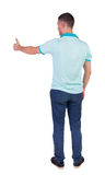 Back view of  man in checkered shirt shows thumbs up. Stock Image