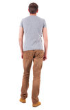 Back view of man in gray shirt and jeans  looking up Stock Photos