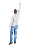 Back view of  man in gray sweater raised his fist up. Back view of  man in gray sweater raised his fist up in victory sign.  Collection of rear view people Stock Image