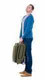 Back view of man with  green suitcase looking up. Royalty Free Stock Image