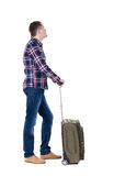 Back view of man with green suitcase looking up. Rear view people collection. backside view of person. Isolated over white background. Unshaven man in a plaid stock photos