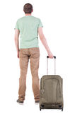 Back view of man with  green suitcase looking up Stock Photo