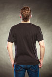 Back view man guy in blank shirt with copy space. Stock Image