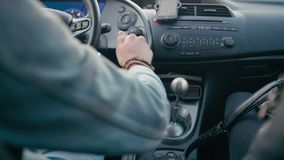 Man Driving Car and Switching Speed by Gear Shift Lever of Manual Transmission. Back View of Man Hand Switching the Fifth Speed by Metal Gear Shift Lever of stock video footage