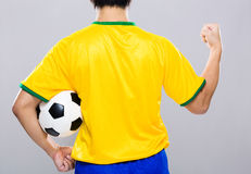 Back view of man hold soccer ball and fist up Royalty Free Stock Photo