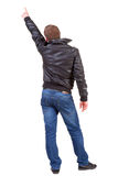 Back view of  man in jacket  pointing. Royalty Free Stock Images