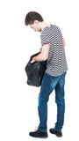 Back view of man in jeans with bag Stock Image