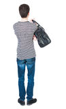 Back view of man in jeans with bag Stock Photo