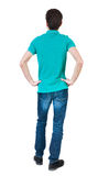 Back view of man in jeans Stock Images