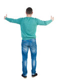 Back view of man in jeans. Standing young guy. Royalty Free Stock Images