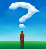 Back view of a man looking at a cloud shaped like a question mark Royalty Free Stock Photography