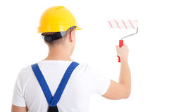 Back view of man painter in workwear with paintbrush isolated on Stock Image