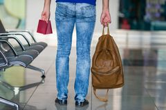 Back view of man with passports and backpack in Royalty Free Stock Photography