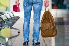 Back view of man with passports and backpack in Stock Photos