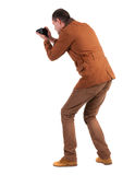 Back view of man photographing. Royalty Free Stock Image