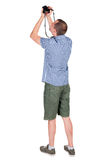 Back view of man photographing. Royalty Free Stock Photo