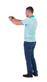 Back view of man photographing. tourist with camera. Royalty Free Stock Photos