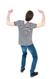 Back view. man  protects hands from what is falling from above. Royalty Free Stock Photos