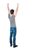Back view of  man.  Raised his fist up in victory sign. Royalty Free Stock Photos