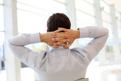 Back view of man relaxing at work Royalty Free Stock Photography