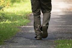 Back view man`s feet walking away.  stock photos