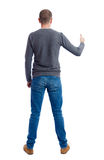 Back view of  man in shirt shows thumbs up.   Rear  people collection. Royalty Free Stock Image
