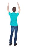 Back view of  man in shirt shows thumbs up. Stock Image
