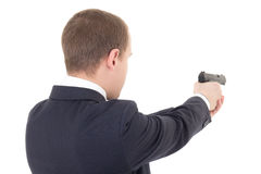Back view of man shooting with gun isolated on white Stock Images