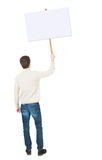 Back view man showing sign board. man holds information plate. Stock Image