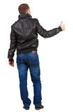 Back view of  man shows thumbs up. Royalty Free Stock Photo