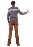 Back view of  man shows thumbs up. Royalty Free Stock Photography