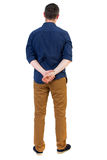 Back view of man . Standing young guy. Rear view people collection.  backside view of person.  Isolated over white background. a man in a blue shirt with the Royalty Free Stock Photography
